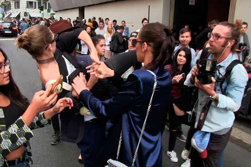 Hadid defending herself from Seduik (Image Source: people.com), crowdink.com, crowdink.com.au, crowd ink, crowdink