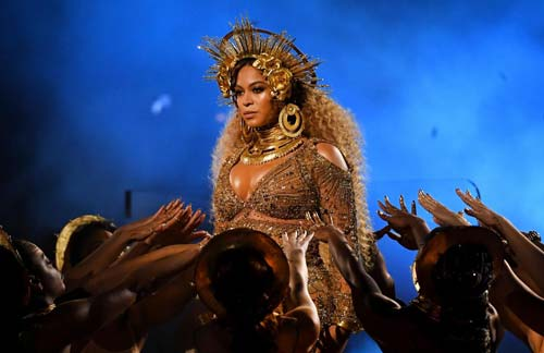 Beyoncé performs while heavily pregnant at the 59th Grammy Awards in Los Angeles earlier this year Kevork Djansezian/Getty