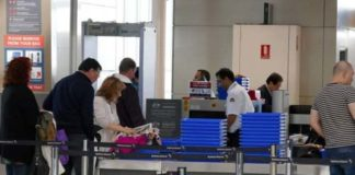 Passengers going through airport security (Image Source: abc), crowdink.com, crowdink.com.au, crowd ink, crowdink