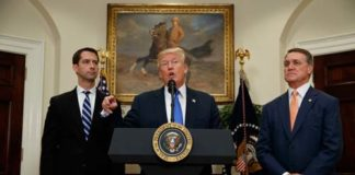 President Donald Trump- RAISE Act (Image Source: The Atlantic) President Donald Trump, flanked by Senators Tom Cotton, left, and David Perdue, speaks in the Roosevelt Room of the White House on August 2, 2017, during the unveiling of the RAISE Act. crowdink.com, crowdink.com.au, crowdink, crowd ink
