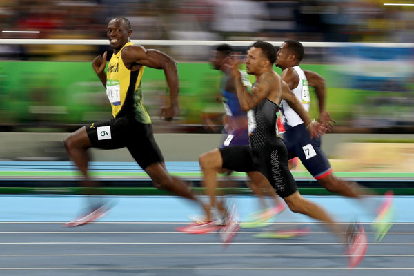 Usain Bolt Manages to be Epic and Cheeky at the Same Time [image source: time.com], crowd ink, crowdink, crowdink.com, crowdink.com.au