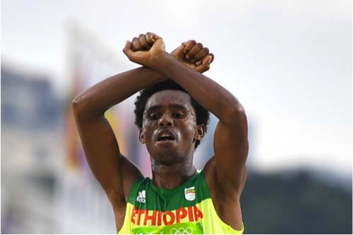 Feyisa Lilesa - For Oromo [Iimage source: Oliver Morin/AFP/Getty Images], crowd ink, crowdink, crowdink.com, crowdink.com.au